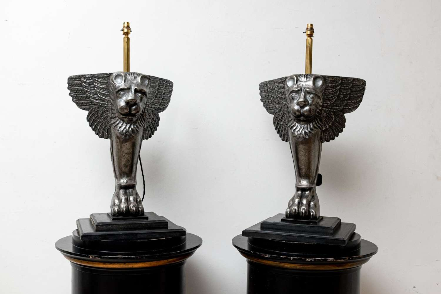 Pair Italian C19th cast iron 'winged lions' converted to lights